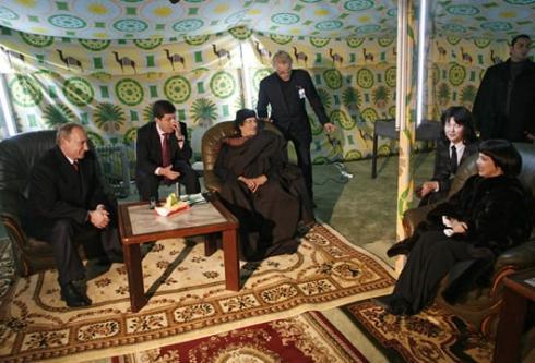 Muammar Gaddafi in his tent with Vladimir Putin [Wikipedia]
