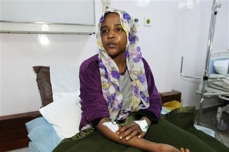 Woman in Tripoli's hospital [Anadolu Agency]