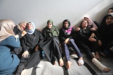 The family of senior Islamic Jihad leader Bahaa Abu Al-Ata mourn after he and his wife are killed in an Israeli strike on his home in the Gaza Strip on 12 November 2019 [Mohammed Asad/Middle East Monitor]