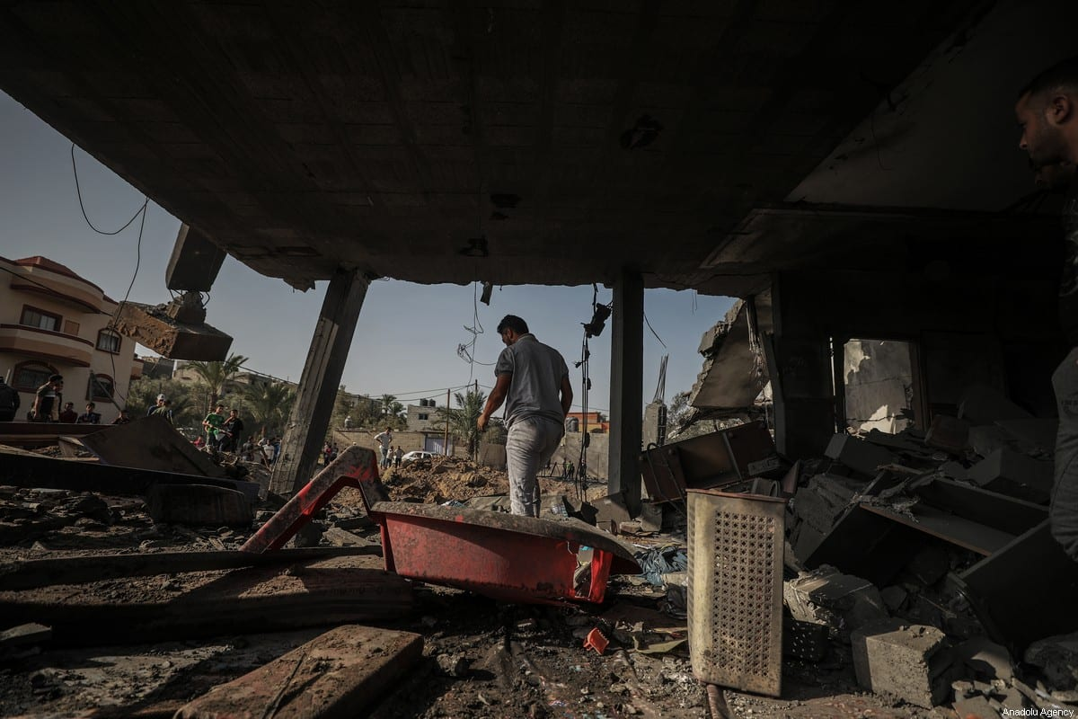 A man clears debris after Israeli airstrikes hit a house in Rafah, Gaza on November 13, 2019 [Ali Jadallah / Anadolu Agency]