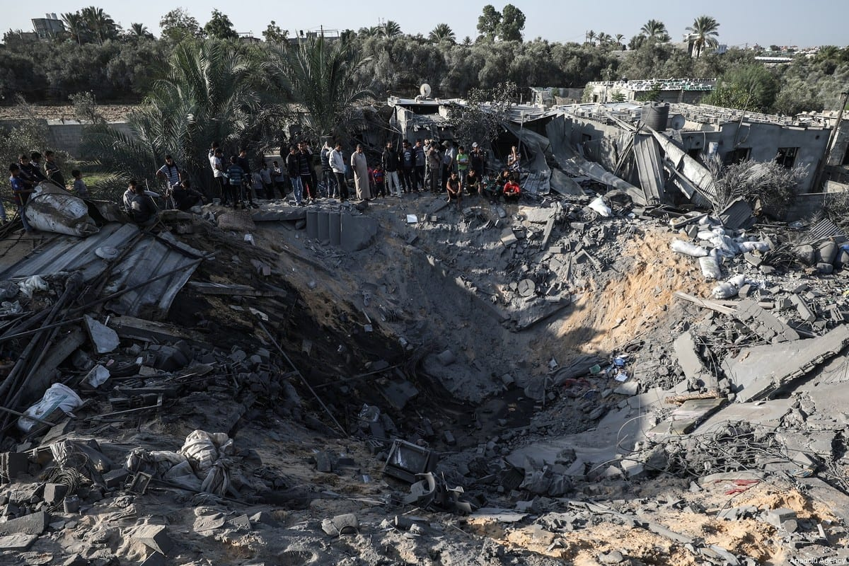 People inspect the debris of a building and huge holes after Israeli airstrikes hit the residential area of Khan Yunis, Gaza on November 14, 2019 [Ali Jadallah/Anadolu Agency]