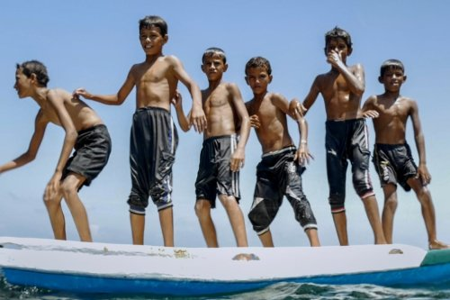 A still from the film 'Gaza' shows a Palestinians boys playing on the beach
