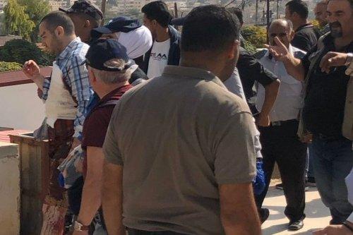 Crowds form at the scene of a stabbing spree in Jerash, Jordan on 6 November 2019