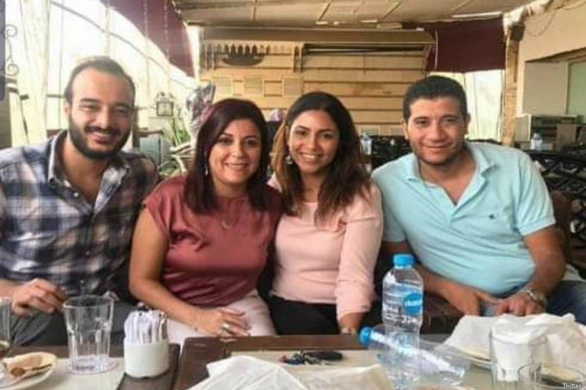 Egyptian journalists Hossam Al-Sayyad (1L), Israa Abdelfattah (2L), Solafa Magdi (CR), Mohamed Salah (R)