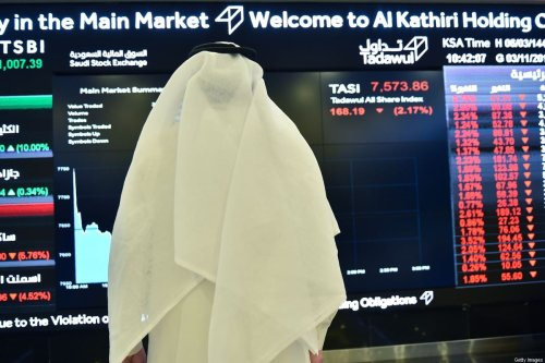A Saudi man monitors an exchange board at the Stock Exchange Market (Tadawul) bourse in Riyadh on November 3, 2019. [FAYEZ NURELDINE/AFP via Getty Images]