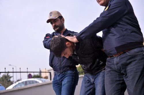 An accused Daesh member(C), captured in operation carried out against terrorist organization Daesh by Turkish National Intelligence and Provincial Security Directorate, is sent to court in Mersin, Turkey on 22 November 2019. [Sezgin Pancar - Anadolu Agency]