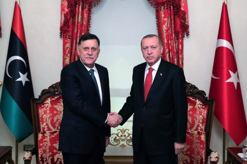President of Turkey, Recep Tayyip Erdogan (R) shakes hands with the chairman of Presidential Council of Libya, Fayez Al-Sarraj (L) as they pose for a photo at Dolmabahce Office in Istanbul, Turkey on 27 November 2019. [Mustafa Kamacı - Anadolu Agency]