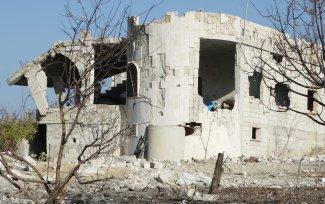 A view of damaged buildings after airstrikes by Assad regime, Russia kill 19 civilians in Bauon village of Idlib, de-escalation zone, Syria on 7 December, 2019 [Ahmet Z. Hatib/Anadolu Agency]