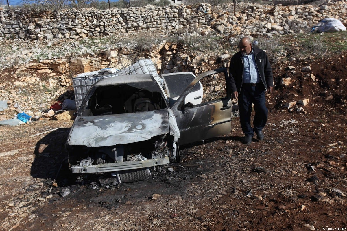 Jewish settlers burn Palestinian's vehicles in Qalqilya, West Bank on December 20, 2019. [Nedal Eshtayah - Anadolu Agency]