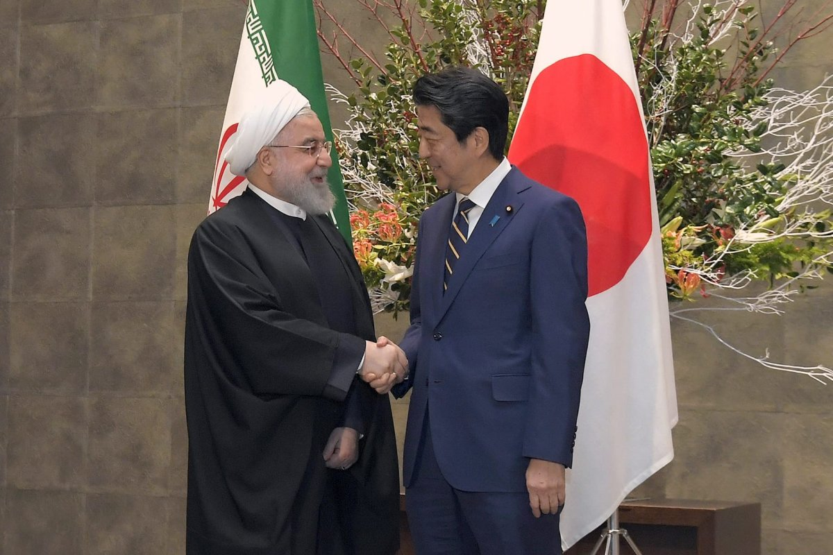 Iranian President, Hassan Rouhani (L) meets with Japanese Prime Minister Shinzo Abe (R) during his official visit in Tokyo, Japan on 20 December 2019 [Presidency of Iran/Handout/Anadolu Agency]