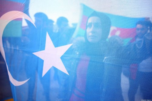 People gather to stage a demonstration in support of Uyghur Turks against human rights violations of China, in Duzce, Turkey on December 20, 2019 [Ömer Ürer / Anadolu Agency]