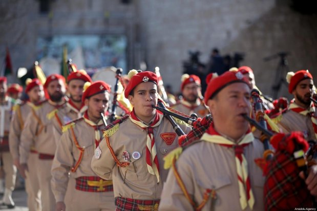 Palestinian marching band performs during a parade as part of the Christmas ceremonies near Church of the Nativity, which believed to be the birthplace of Jesus in Bethlehem, West Bank, on December 24, 2019 [İssam Rimawi - Anadolu Agency]