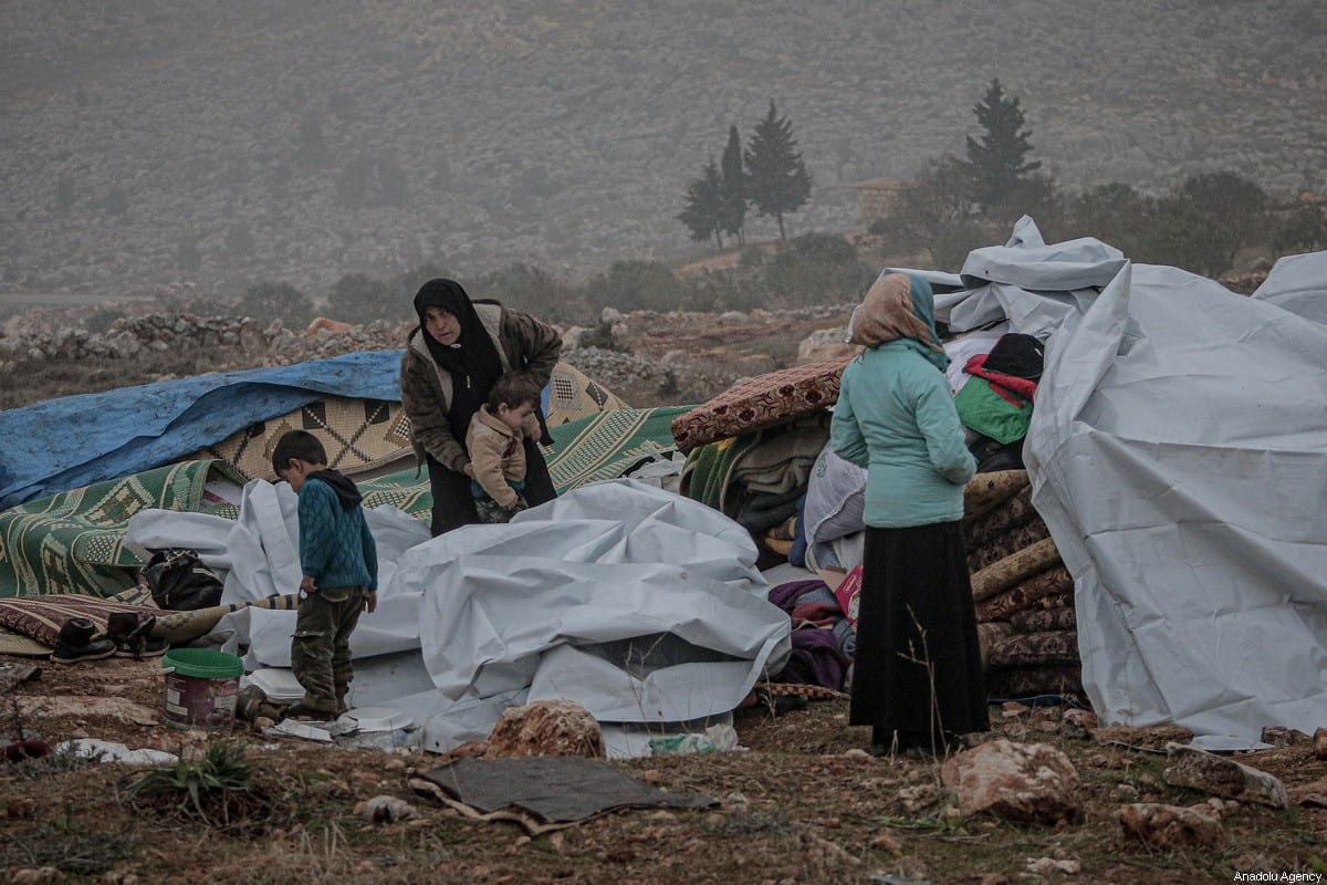 Displaced Syrians are seen in makeshift camps following attacks carried out by Assad regime in Idlib, Syria on 24 December 2019 [Muhammed Said/Anadolu Agency]