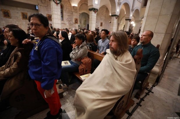 Palestinian Christians attend the Christmas mass at the Church of St. Catherine to lead the ritual to mark Christmas in Bethlehem, West Bank on December 24, 2019 [Issam Rimawi - Anadolu Agency]