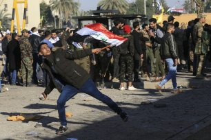 Outraged Iraqi protesters storm the US Embassy in Baghdad, protesting Washington's attacks on armed battalions belong to Iranian-backed Hashd al-Shaabi forces on December 31, 2019 [Murtadha Sudani/Anadolu Agency]