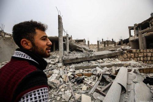 A man is seen around debris of buildings after warplanes belonging to Assad Regime hit Ma'ar Shoreen village, in Ma'arat al-Nu'man district of of Idlib, de-escalation zone, Syria on 15 December, 2019 [İzzeddin İdilbi/Anadolu Agency]