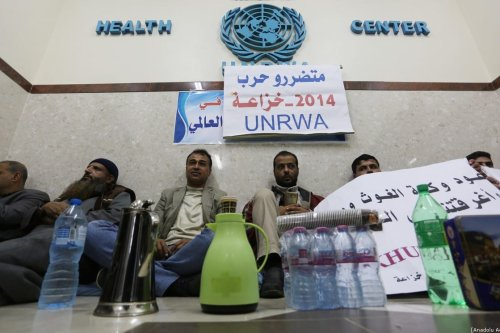 Palestinians, whose houses were damaged due to Israeli attacks on 2014, stage a sit-in protest demanding indemnity payment at UNRWA's building in Gaza City, Gaza on 9 December, 2019 [Ashraf Amra/Anadolu Agency]