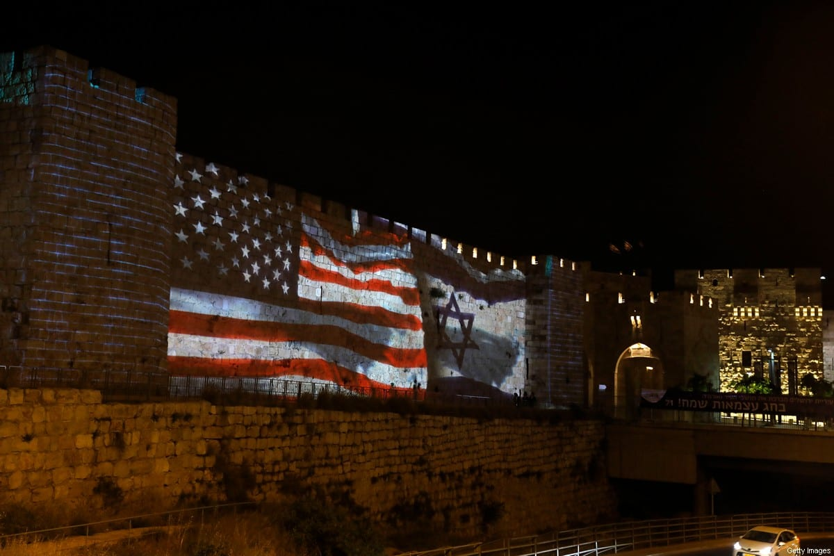 The Israeli and United States flags are projected on the walls of the ramparts of Jerusalem's Old City, to mark one year since the transfer of the US Embassy from Tel Aviv to Jerusalem on May 15, 2019. [AHMAD GHARABLI/AFP via Getty Images]