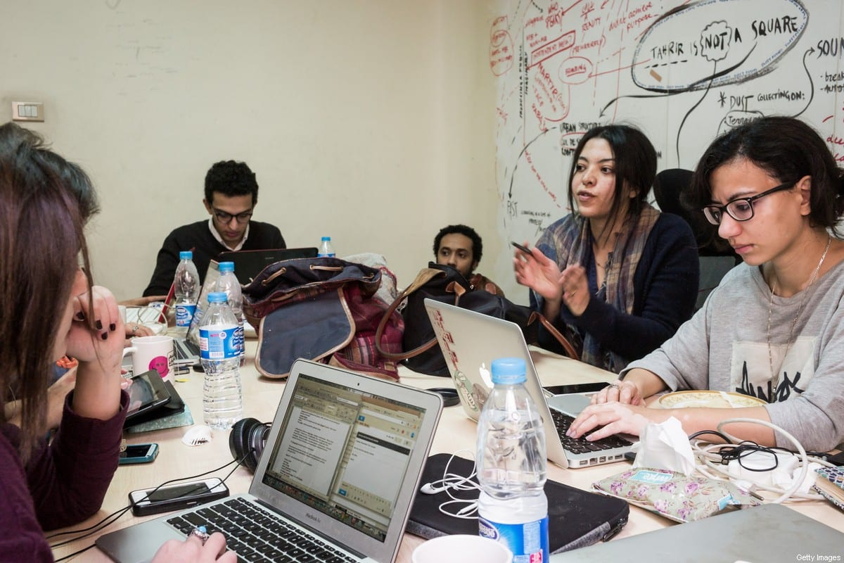 Members of Mada Masr work in their office on January 25 2015 in Cairo, Egypt.Mada Masr is a Cairo-based independent news website [David Degner/Getty Images]