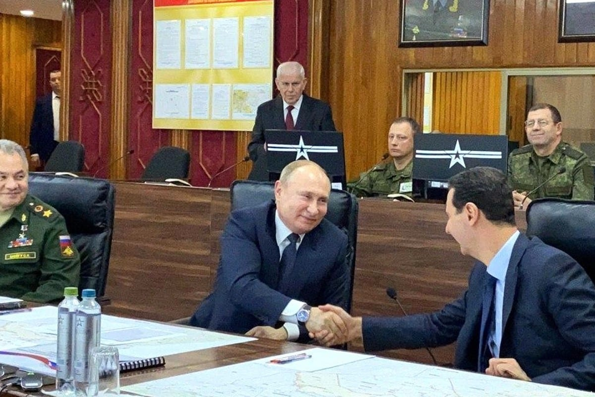 Russian President Vladimir Putin (C) meets Bashar al-Assad in Damascus, Syria on January 07, 2020 [Kremlin Press Office/Handout/Anadolu Agency]