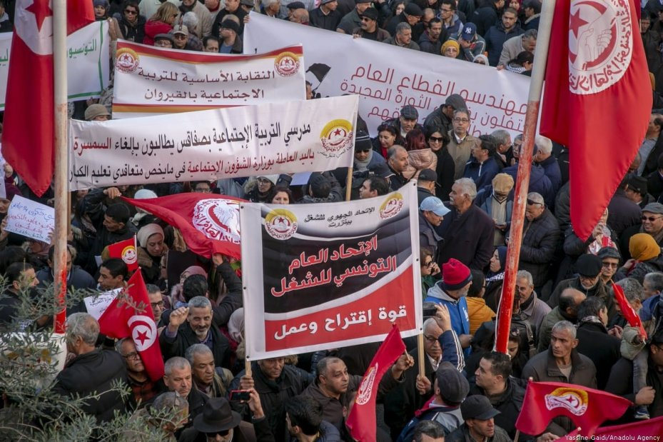 Tunisians gather in front of Tunisian General Labour Union (UGTT) building for the 9th Anniversary of ousting of President Zine El Abidine Ben Ali in Tunis, Tunisia on January 14, 2020. [Yassine Gaidi/Anadolu Agency]