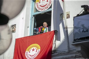 Tunisian General Secretary of Labour Union (UGTT) Noureddine Taboubi makes a speech asTunisian gather in front of Tunisian General Labour Union (UGTT) building within 9th Anniversary of ousting of President Zine El Abidine Ben Ali in Tunis, Tunisia on January 14, 2020. [Yassine Gaidi/Anadolu Agency]