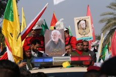 People attend the funeral ceremony of Qasem Soleimani, commander of the Iranian Revolutionary Guards' Quds Forces, and Abu Mahdi al-Muhandis, vice president of the Hashd al-Shaabi group, killed by US strike near Baghdad International Airport, in Baghdad, Iraq on January 4, 2020 [Murtadha Sudani / Anadolu Agency]