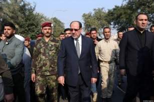 Former Prime Minister of Iraq Nouri al-Maliki (L) attends the funeral ceremony of Qasem Soleimani, commander of the Iranian Revolutionary Guards' Quds Forces, and Abu Mahdi al-Muhandis, vice president of the Hashd al-Shaabi group, killed by US strike near Baghdad International Airport, in Baghdad, Iraq on January 4, 2020 [Murtadha Sudani / Anadolu Agency]