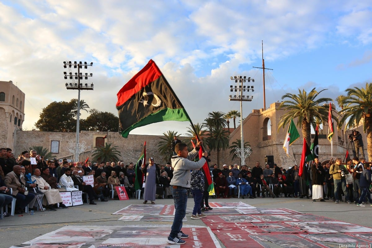 A child hold a flag of Libya during a demonstration against eastern military commander Khalifa Haftar, who is based in the east of the country, and in support of the UN-recognised government of national accord (GNA) at Martyrs' Square in Tripoli on 10 January 2020. [Hazem Turkia - Anadolu Agency]