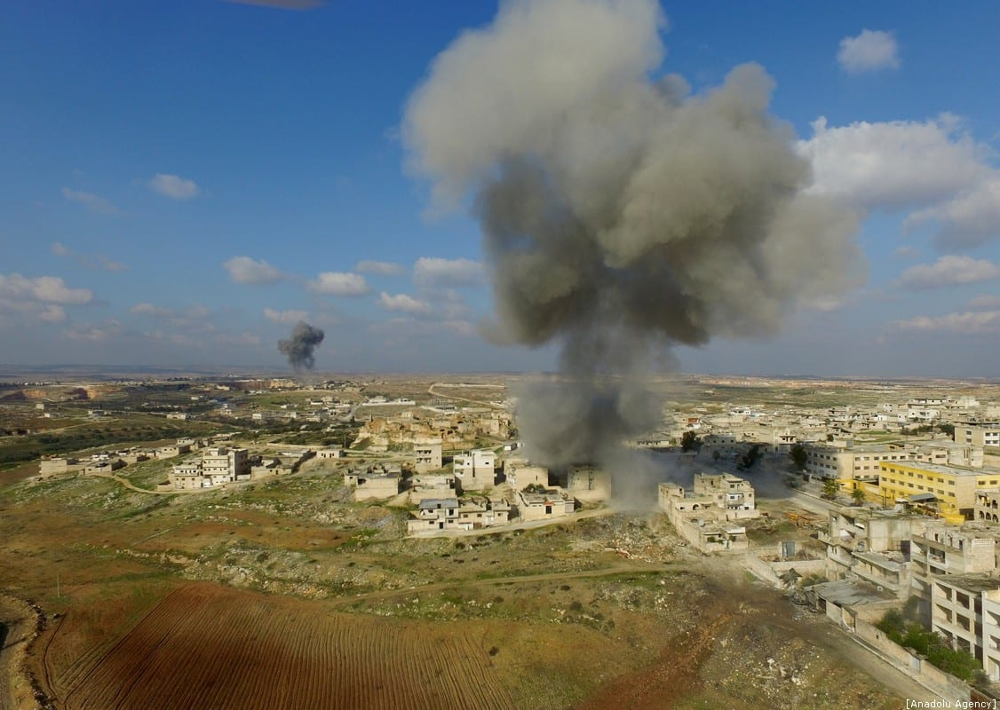 Drone photo shows smoke billowing from Maarat Al-Numan district after hit by Assad Regime forces' airstrikes in Idlib, Syria on 11 January 2020. [İzzeddin İdilbi - Anadolu Agency]