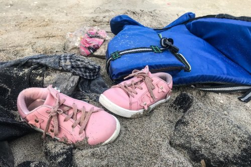 A pair of a child's shoes is seen after a boat carrying 19 irregular migrants capsized off the coast of Cesme in the Aegean province of Izmir, Turkey on 12 January 2020 [Mahmut Serdar Alakuş/Anadolu Agency]