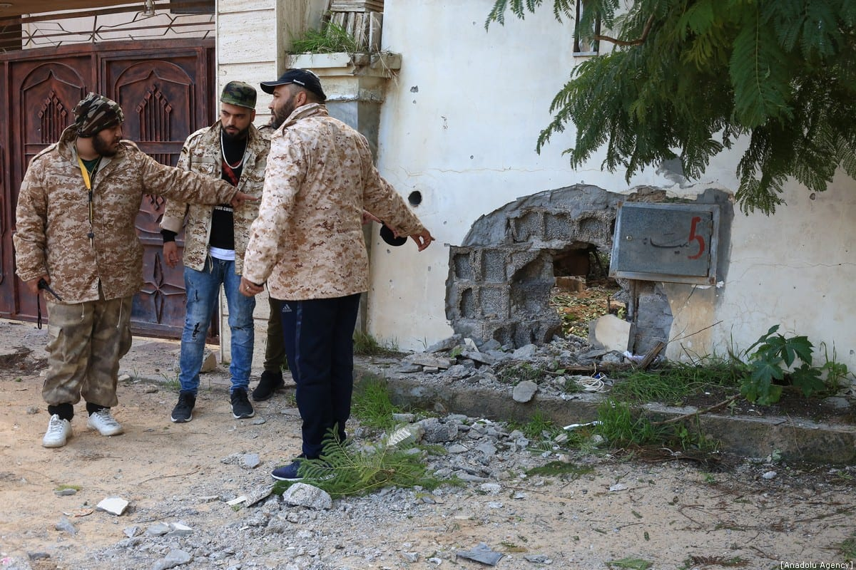 National Covenant Government (UMH) members inspect the damages following bombings, as they patrol at checkpoints established by the conflict zones, after Libya's renegade Gen. Khalifa Haftar accepted a joint call by Turkey and Russia for a cease-fire and truce in the battle for Tripoli, at Salah al-Din town of Tripoli in Libya on 12 January 2020. [Enes Canlı - Anadolu Agency]