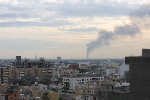 Smoke rises after forces of Warlord Khalifa Haftar attacked to capital Tripoli, Libya on 19 January 2020. [Enes Canlı - Anadolu Agency]