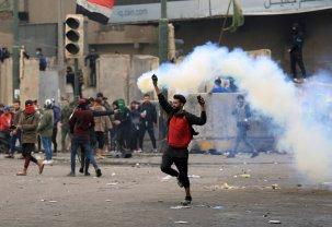 Demonstrator at Tahrir Square in the centre of the Iraqi capital Baghdad, on January 25, 2020 [Murtadha Al-Sudani/Anadolu Agency]