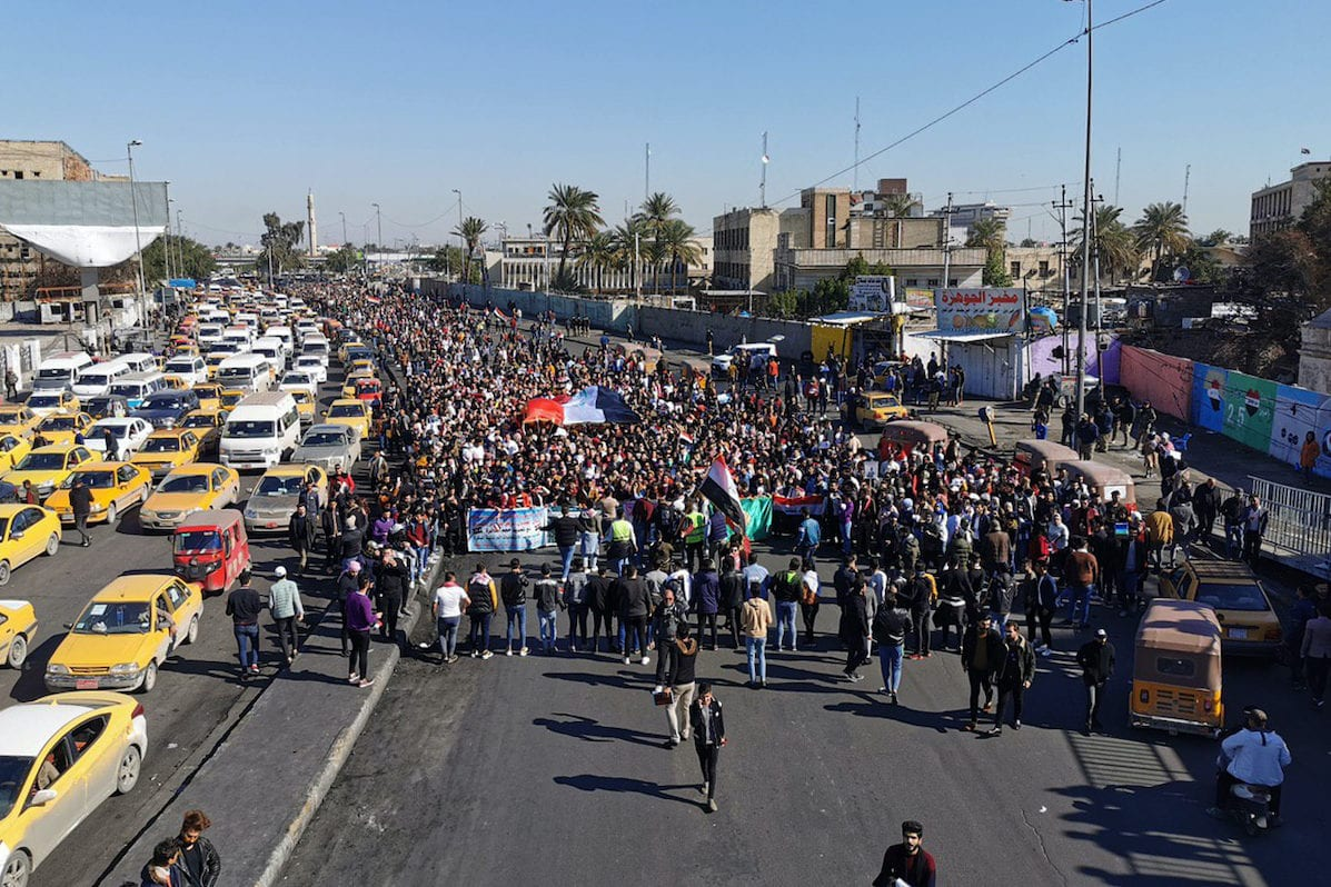 Anti-government protesters gather at Tahrir square in Iraqi capital Baghdad on 26 January 2020. [Murtadha Al-Sudani - Anadolu Agency]
