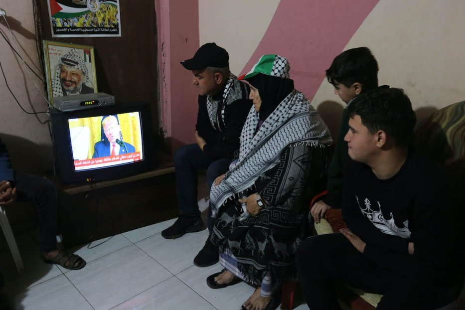 "Palestinians watch so-called ""Deal of the Century"" announced by U.S. President Donald Trump on Television in Khan Yunis, Gaza on 28 January 2020. [Ashraf Amra - Anadolu Agency]"