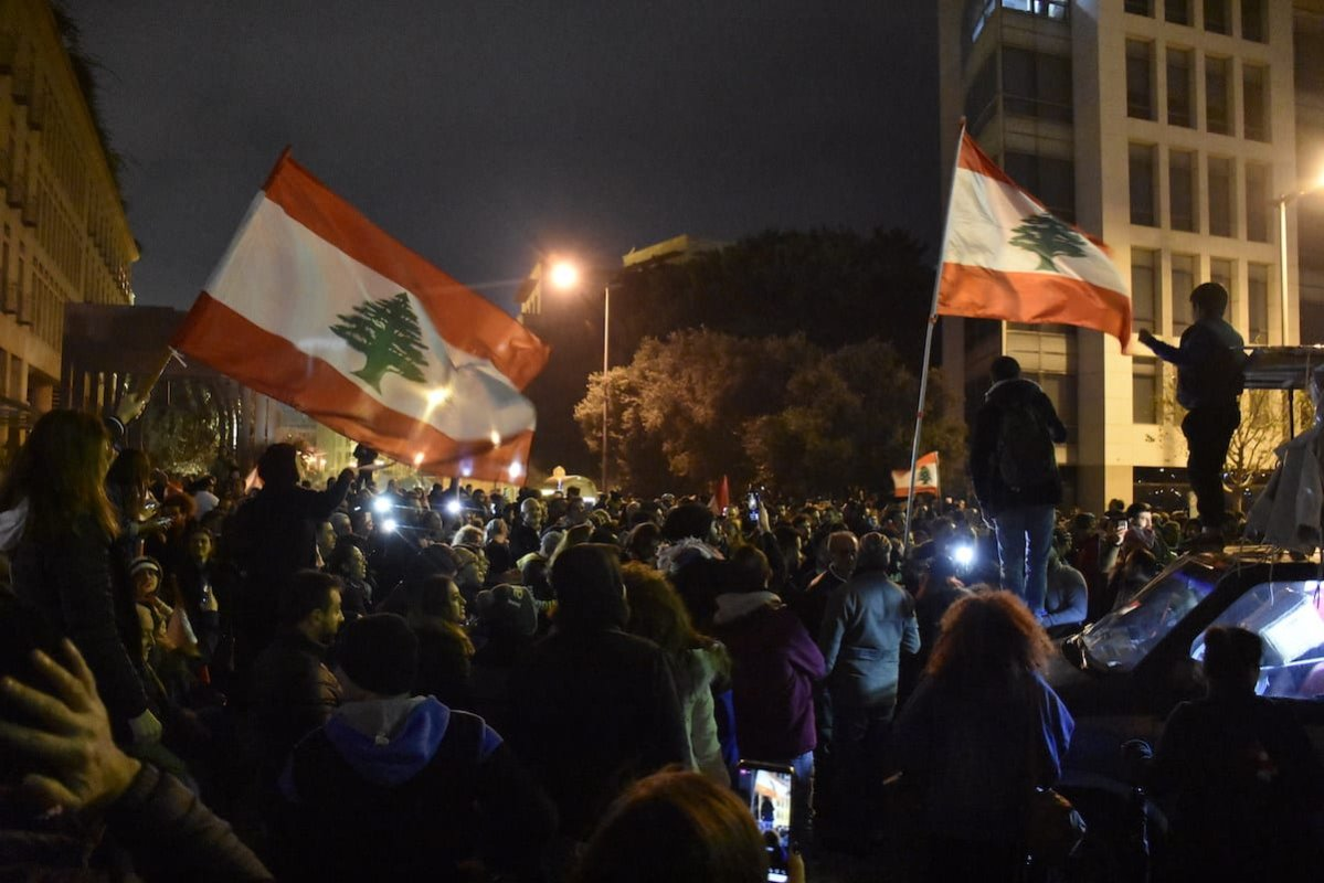 People stage a demonstration against the new government of Hassan Diab' at in Beirut, Lebanon on 28 January 2020 [Mahmut Geldi/Anadolu Agency]