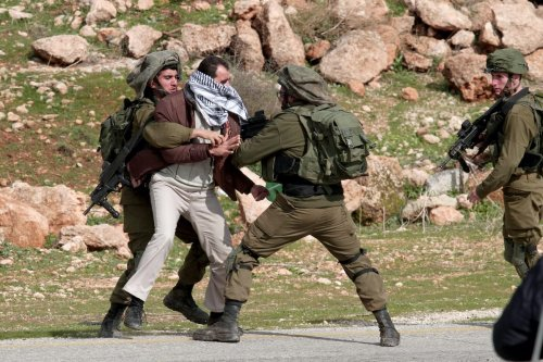 Israeli soldiers intervene in Palestinians during a protest against U.S. President Donald Trump's peace plan in Tubas, West Bank on January 29, 2020 [Nedal Eshtayah/Anadolu Agency]