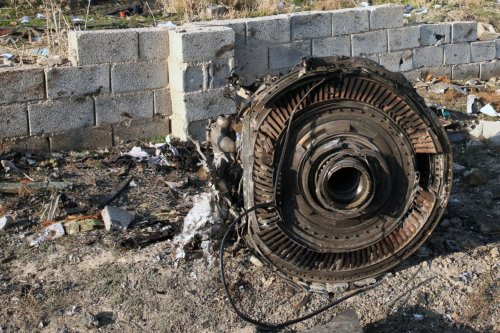 An engine lies on the ground after a Ukrainian plane carrying 176 passengers crashed near Imam Khomeini airport in the Iranian capital Tehran early in the morning on January 8, 2020, killing everyone on board [AFP via Getty Images]