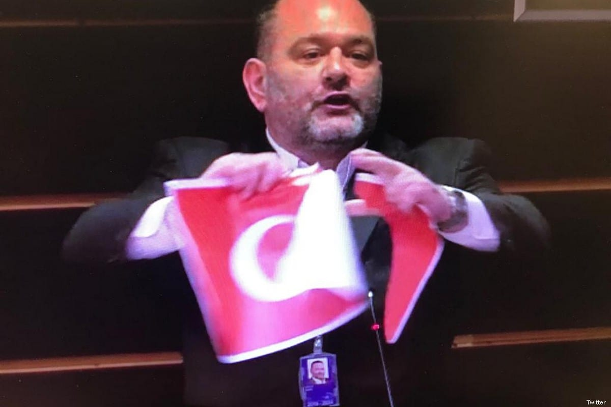Greek MEP Ioannis Lagos tore apart the Turkish flag during a parliamentary session on 30 January 2020 [Twitter]