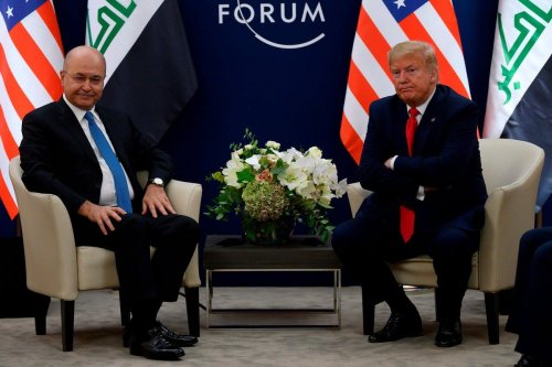 Iraqi President Barham Salih (L) and US President Donald Trump at the World Economic Forum in Davos, Switzerland on 21 January 2020 [Twitter