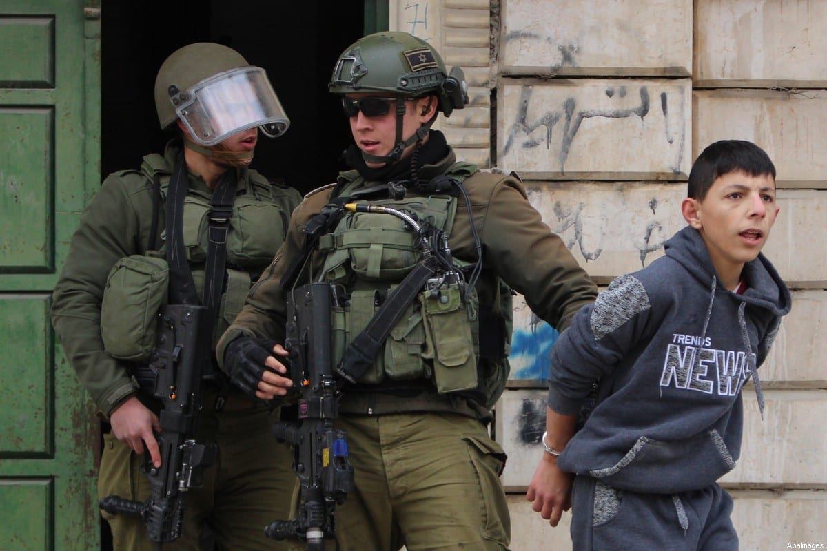 Israeli security forces arrest a Palestinian boy on 11 February 2020 [Mosab Shawer/ApaImages]
