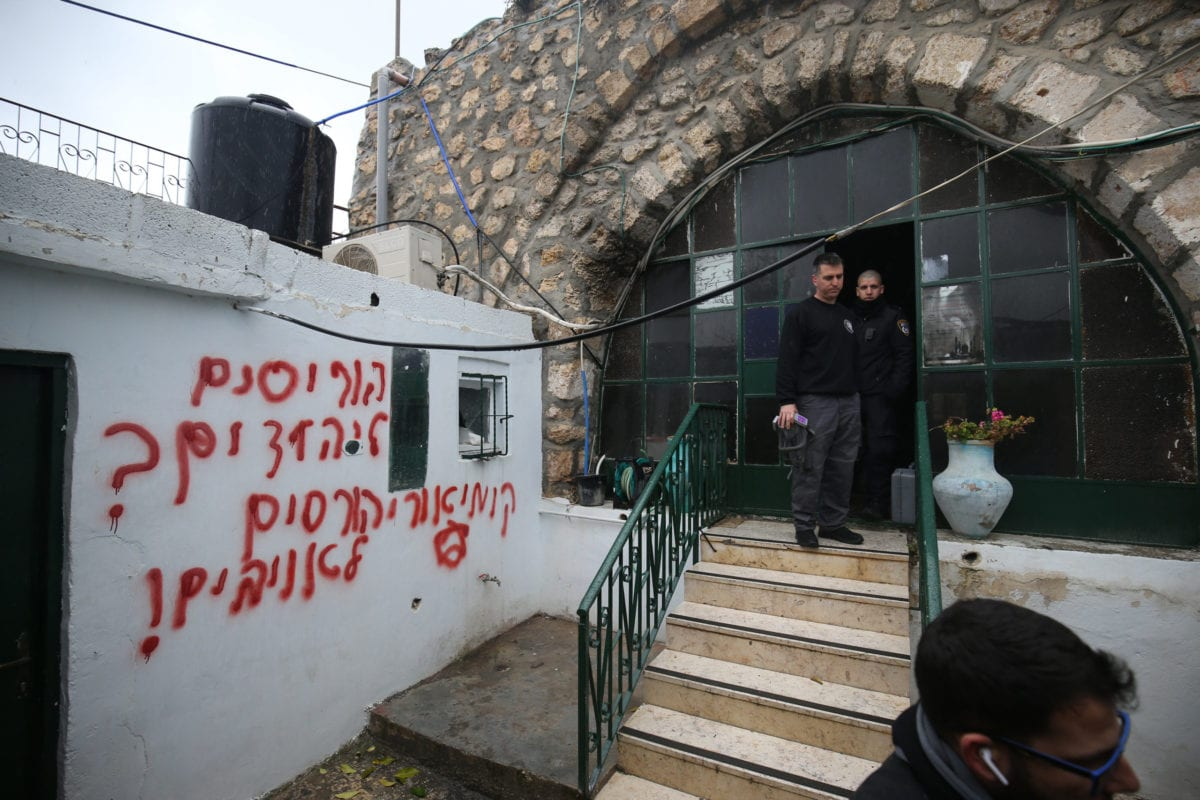 A view of Hebrew racial slurs on the wall of the mosque sprayed by Jewish settlers as eyewitnesses reported that a group of settlers set fire to the Badriya mosque in Beit Safafa town in Jerusalem on 24 January 2020. [Mostafa Alkharouf - Anadolu Agency]