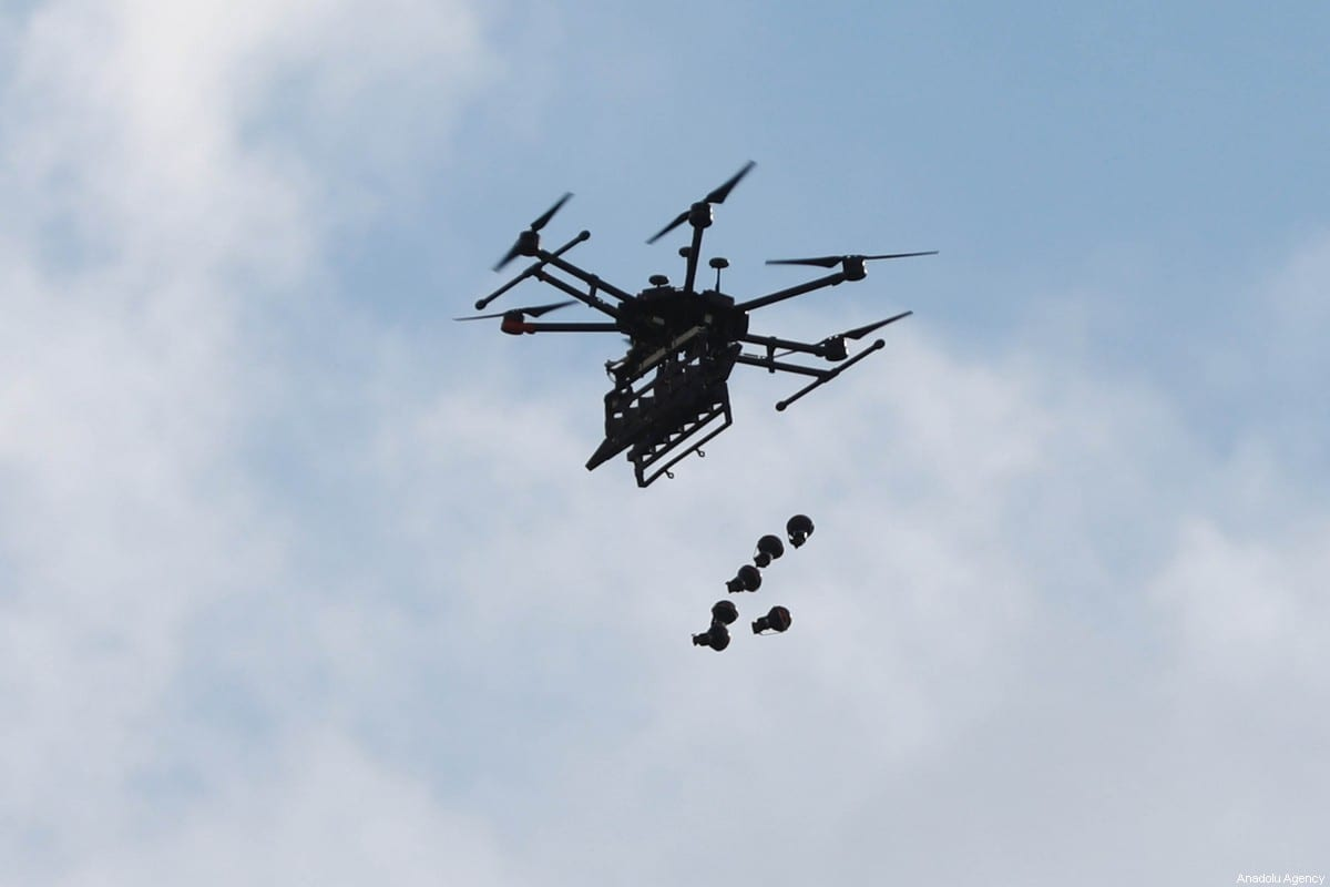 Israeli forces launch tear gas with a drone to disperse protesters during a protest against US President Donald Trump's Middle East plan, near Beit El checkpoint in Ramallah, West Bank on January 30, 2020 [Issam Rimawi / Anadolu Agency]