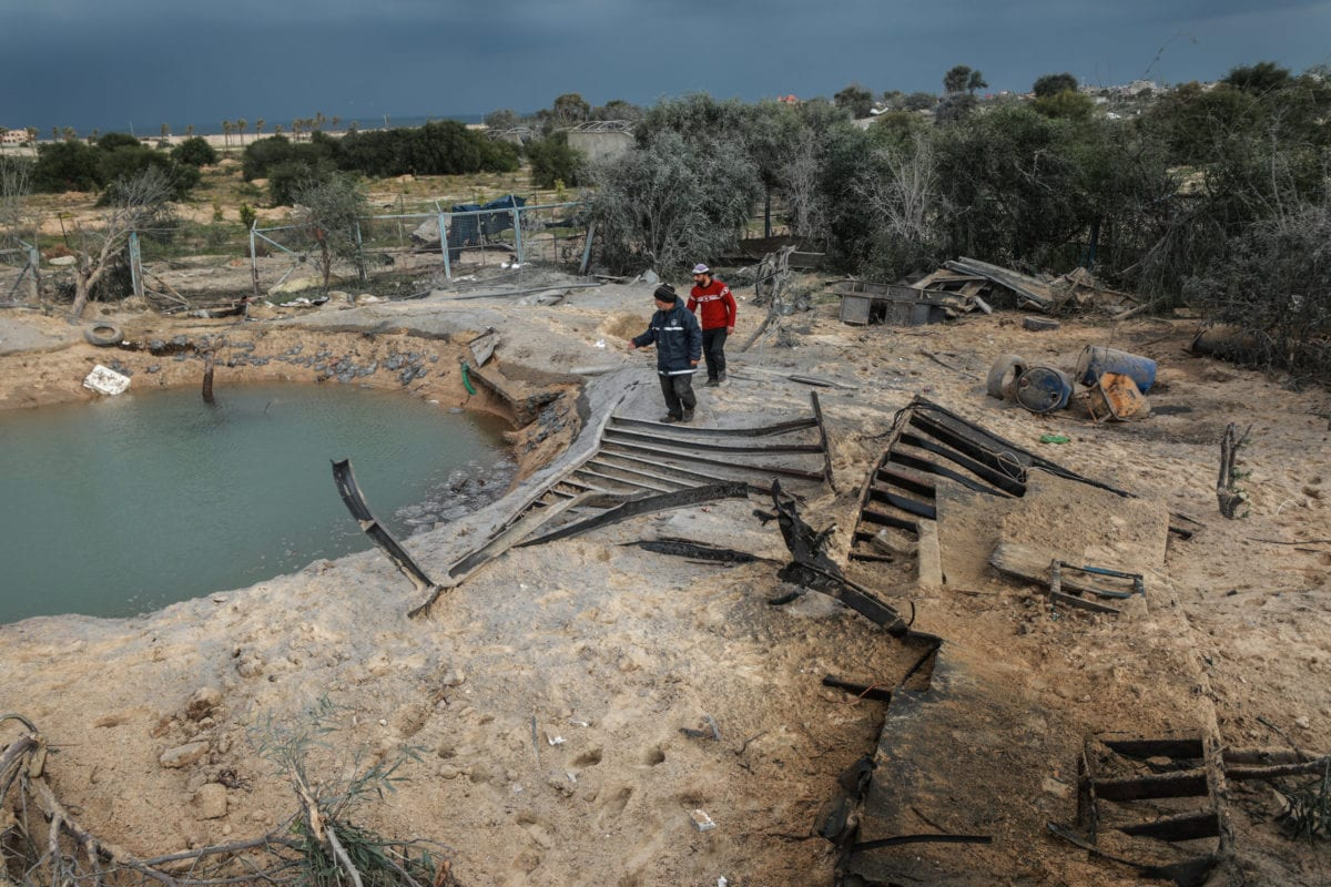 Palestinians inspect a water well after Israeli warplanes carried out an airstrike over Rafah, Gaza on January 31, 2020 [Ali Jadallah / Anadolu Agency]