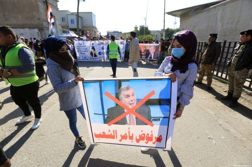 Iraqi people stage a protest against former communications minister Mohammed Tawfiq Allawi after Iraqi President Barham Salih has assigned Allawi to form new government, in Iraqi capital Baghdad on February 2, 2020 [Murtadha Al-Sudani / Anadolu Agency]