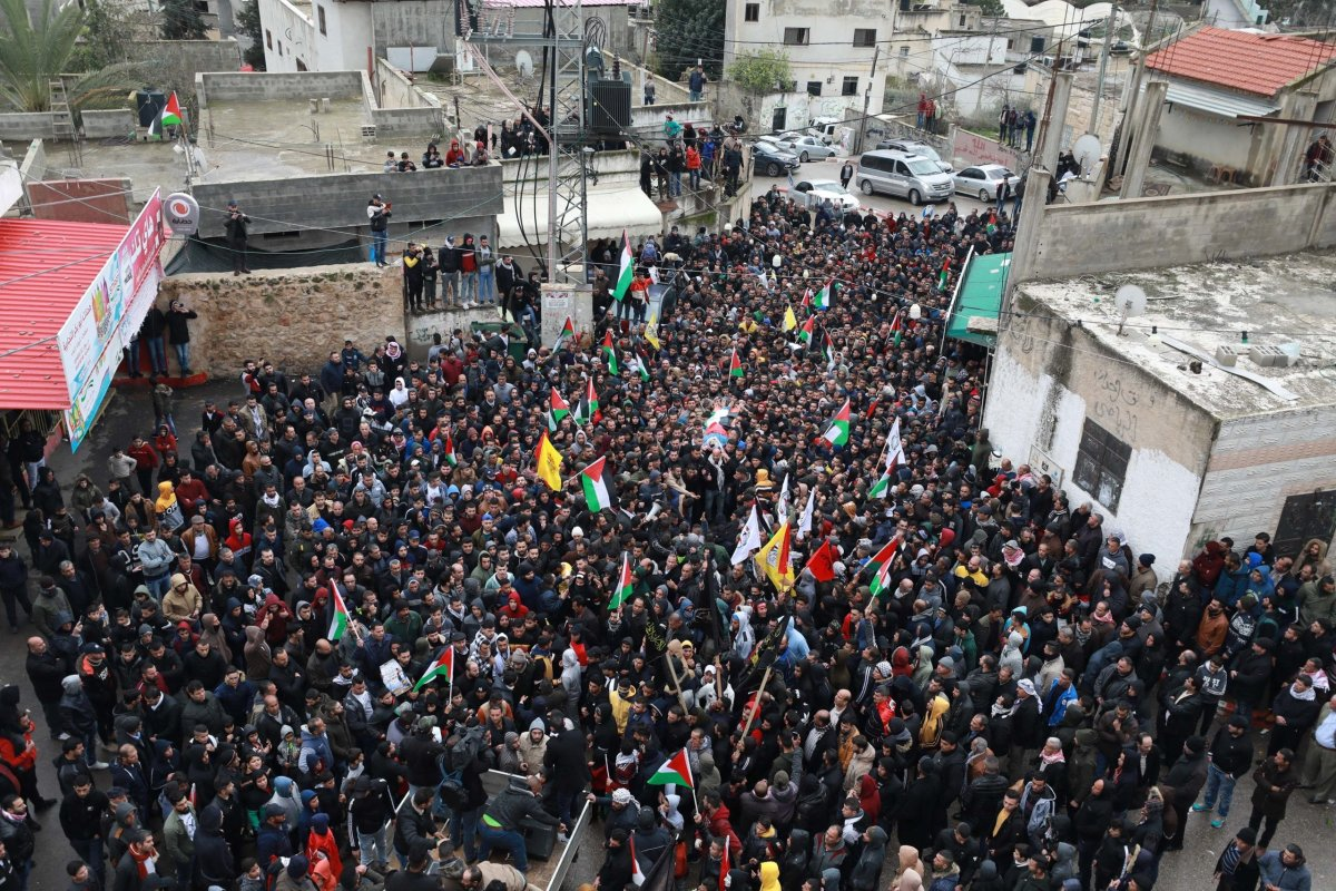 Palestinians carry the dead body of 19 year-old Bedr Nidal Nafile who was killed in Israeli forces' intervention, during a funeral ceremony in Tulkarm, West Bank on 8 February, 2020 [Issam Rimawi/Anadolu Agency]