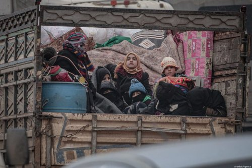 Syrian civilians, with their belongings are on their way to safer zones near Turkish border as they flee their homes due to the airstrikes of Assad regime forces and Russia, in northwestern Syria's Idlib de-escalation zone, on 13 February 2020. [Muhammed Said - Anadolu Agency]
