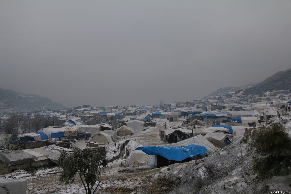 An overlook of a refugee camp in Idlib, Syria, covered in snow, on February 13, 2020 [Hadi Harrat / Anadolu Agency]