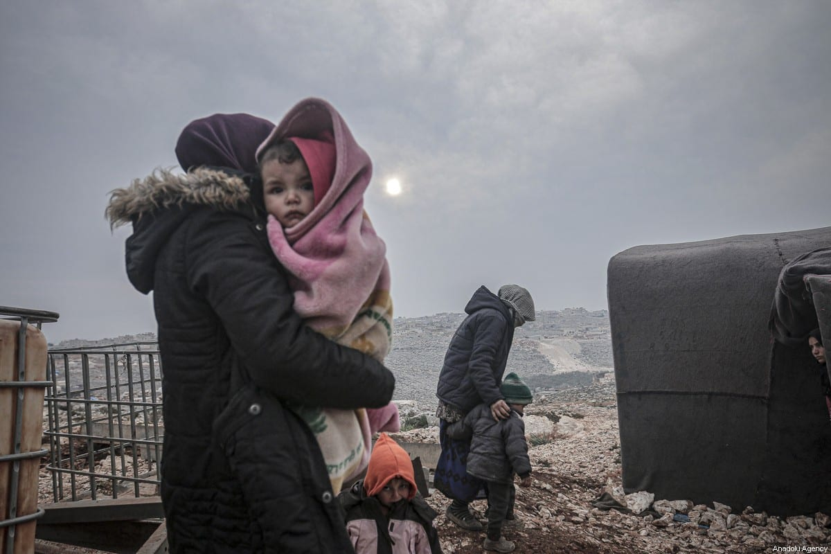 Syrian families, who have been forcibly displaced due to the ongoing attacks carried out by Assad regime and its allies, are seen at a camp in Turmanin in the western rural of Aleppo near Turkish border on a cold winter day in Idlib, Syria on 14 February 2020. [Muhammed Said - Anadolu Agency]